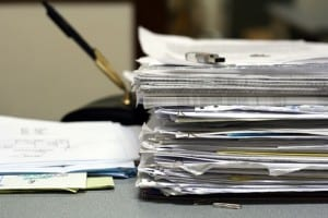 thumb drive and pile of financial papers