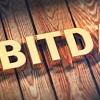 Acronym EBITDA on wood planks