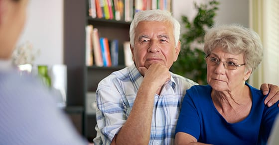 husband and wife couple discuss estate planning with professional