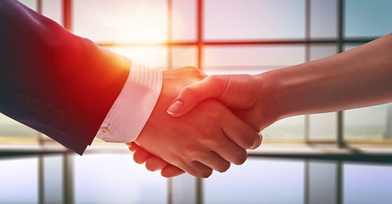 business man and woman shaking hands to close business deal   handle buy-sell agreements with care   Dalby, Wendland & Co., P.C.   CPAs   Business Advisors   Grand Junction CO   Glenwood Springs CO   Montrose CO