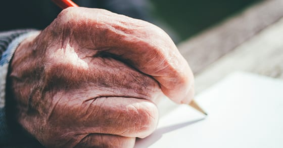 Aged persons hand writing letter | estate planning letter of instructions| Dalby Wendland & Co PC | CPAs & Business Advisors