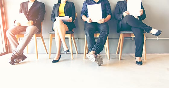 men and women sitting holding resumes to apply for a job | Independent Contractor vs. Employee | Dalby, Wendland & Co., P.C. | CPAs | Business Advisors