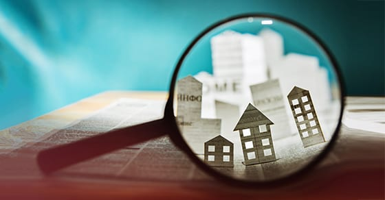 property and real estate showing through a magnifying glass | 1031 exchange | Dalby Wendland & Co | CPAs | Business Advisors | Colorado | Grand Junction | Glenwood Springs | Montrose