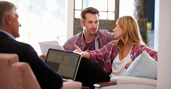 couple sitting with tax advisor | 2018 Tax Planning for Individuals | Dalby Wendland & Co. | CPAs | Business Advisors | Colorado | Grand Junction | Glenwood Springs | Montrose