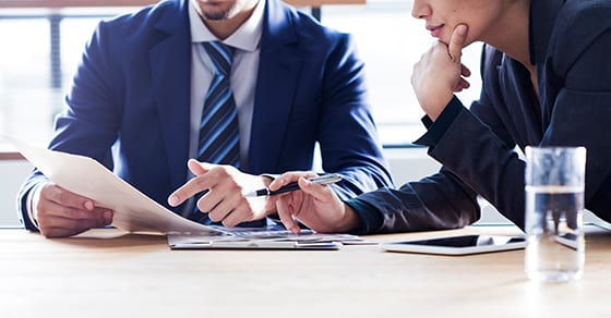 man and woman discussing business | TCJA provisions affecting small businesses | Dalby Wendland & Co. | CPAs | Business Advisors | Colorado | Grand Junction | Glenwood Springs | Montrose