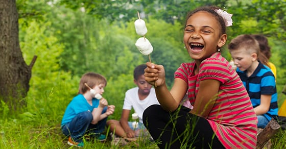 kids roasting marshmallows at day camp | child and dependent care credit | Dalby Wendland & Co. | CPAs | Business Advisors | Colorado | Grand Junction | Glenwood Springs | Montrose