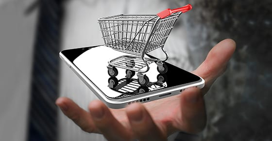 mini shopping cart sittting on smart phone | collecting sales tax on all out-of-state online sales | Dalby Wendland & Co. | CPAs | Business Advisors | Grand Junction CO | Glenwood Springs CO | Montrose CO