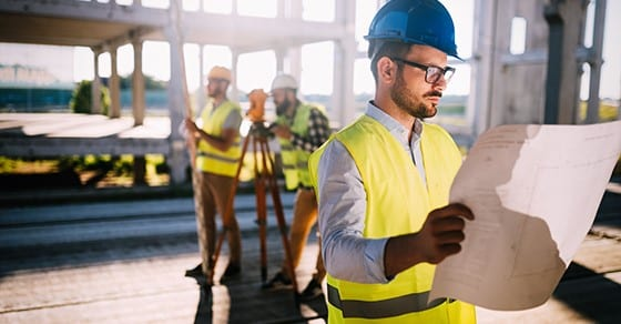 contractor looking at building plans | cost segregation study | Dalby, Wendland & Co., P.C. | CPAs | Business Advisors | Grand Junction CO | Glenwood Springs CO | Montrose CO