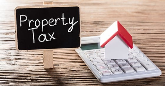 blackboard with property tax written on it | prepaying property taxes | Dalby, Wendland & Co., P.C. | CPAs | Business Advisors | Grand Junction CO | Glenwood Springs CO | Montrose CO